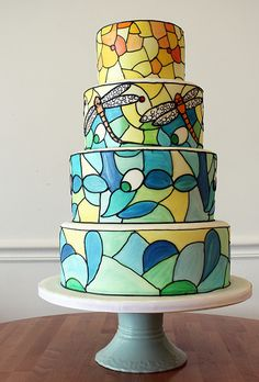 Brides.com: . The couple's favorite Tiffany lamp became the inspiration for this unique and vibrant wedding cake from Oakleaf Cakes Bake Shop. Each tier was hand-painted using an airbrushing technique to create the look of mosaic glass.   $12 per slice, Oakleaf Cakes Bake Shop