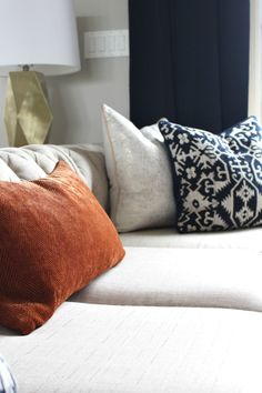 Pillows from Homegoods complete this beautiful, modern loft makeover for a fall home tour.