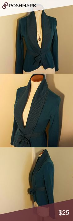 """New York & Co Sparkle Knit Blue Wrap Sweater XS Cute dressy cardigan sweater from New York & Company. Size XS. Lovely jewel-toned dark teal blue color.  Shawl ribbed collar, wrap front, with attached tie belt and tulip hem.  Sparkle knit at collar, tie, hemline, and cuffs.  Slim fit, ties at natural waist.  Bust approx 30-34"""", length 21"""".  Like new, only worn a couple times.  Perfect Fall and Winter, and great for upcoming Holidays! New York & Company Sweaters Cardigans"""