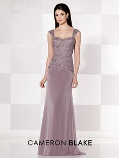 Sleeveless two-tone chiffon and lace slim A-line gown with hand-beaded lace illusion tapered straps, sweetheart neckline, lace drop waist bodice, sweep train. Matching shawl included.Sizes: 4 - 20