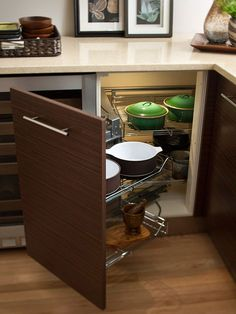 Work with a Designer    Customize your storage with a certified kitchen designer. A corner cabinet like this one would generally house a lazy Susan. However, with a designer's creative vision, this cabinet was instead outfitted with pullout metal shelving that makes it easier to store and retrieve cooking equipment and small appliances.