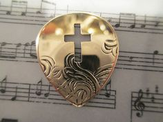 Brass Cross Guitar Pick.  Click on the picture to buy!