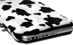 a1ac5f5bf5c People who like products with a cow print on it will be blown away by the  design of the Lazy Cow! This laptop sleeve has the appearance of a cowhide.