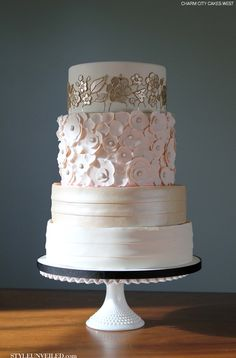 Aaa- love this cake! Different design on every layer, elegant- gorgeous! Billie by Charm City Cakes West / Wedding Cake / via Style Unveiled
