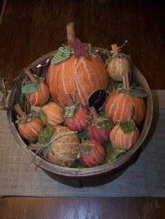 Ragball pumpkins with cinnamon sticks.