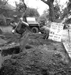 Two Canadian soldiers digging a trench during the attack. From left to right: Rusty Forsythe signaller, Captain RW Armstrong. Normandy, 1944.
