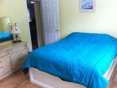 Queen sized bed in second beroom.