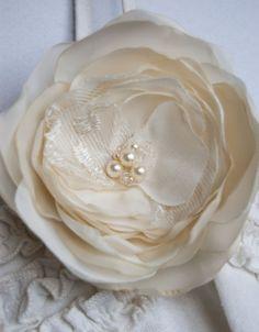 Bridal hair flower brooch and hair clip, ivory bridal hair flowers, wedding hair accessories, light cream, lace, swarovski pearls. $18.00, via Etsy.
