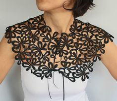 This bridal capelet, cape, shrug, wedding cover up is made with black guipure lace. Its tied with two thin black ribbon over one shoulder-chest part. With its modern and minimal look, it can be used as a complementary accessory for dresses. My unique design, simple and chic, it will make you feel you chic, simple yet comfortable. One size fitting to S to L sizes (The model at the picture is in M size)  *** Matching items for this capelet are available; It can be done a combination with the…