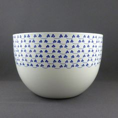 Kaj Franck for Finel blue clover bowl. Just found in my basement. Thought I would do some research. Must save this vintage bowl and stop serving the kids chips in it.