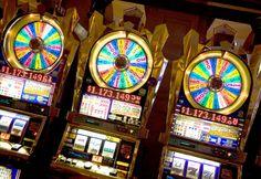 Slot machines in casino, Las Vegas (© Bob Masters/Alamy)