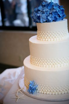 Simple cake with clay-flower topper- just lovely | Photo by Melissa McClure Photography