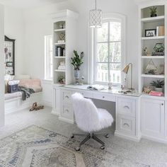 Gorgeous bedroom built-in desk and shelves designed under a window and a trellis pendant.