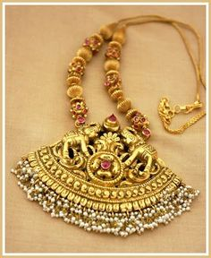 Temple necklace carved with elephants , mangoes and suspended with pearls