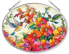 Amia Oval Suncatcher with Hummingbird Design, Hand Painted Glass, 6-1/2-Inch by 9-Inch by Amia. $23.45. Includes chain. Comes boxed, makes for a great gift. Handpainted glass. Amia glass is a top selling line of handpainted glass decor. Known for tying in rich colors and excellent designs, Amia has a full line of handpainted glass pieces to satisfy your decor needs. Items in the line range from suncatchers, window decor panels, vases, votives and much more.