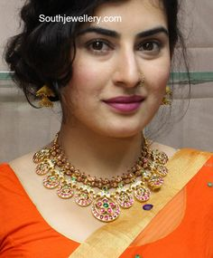 Archana in a traditional gold necklace photo