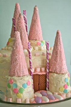 Easy Castle Cake inspiration... like the cones covered in frosting and rolled in sugar sprinkles.