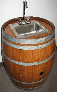 Wine Barrel Wet Bar with Stainless Sink & Chrome Faucet. $990.00, via Etsy.