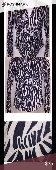 """Lilly Pulitzer Navy & White Zebra Entourage Shirt Gorgeous button down shirt with pointy collar and gold buttons on front and three-button cuffs Sharp dark navy blue and white """"Entourage"""" zebra print Excellent, gently used condition Approximate measurements: Chest = 15"""" across laid flat Length =  23"""" from shoulder seam to bottom of shirt Sleeve Length = 23"""" from shoulder seam to cuff Lilly Pulitzer Tops Button Down Shirts"""