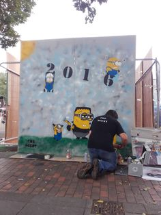 #Streetartist #TheAgent working progress on his #Minions #Artwork at #Hypefest #Gloucester #2016.