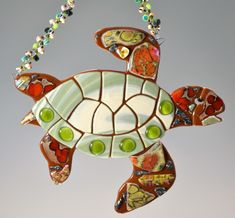Designer of large handmade stained glass suncatchers using whimsical beach themed designs. Featuring sand dollars, mermaids, sea horses, starfish and whimsical fish. Stained Glass Suncatchers, Fused Glass, Glass Fusing Projects, Bee Creative, Wedding Crafts, Glass Garden, Beach Themes, Beaded Embroidery, Glass Art