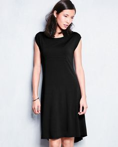 This feminine dress by Eileen Fisher flatters the body — especially in a favorite fabrication that floats over curves without clinging. The put-together dress features an empire waist, curved seams, and an asymmetrical hem, and easily shifts into dress-up mode with a few well-chosen accessories.