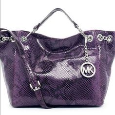 Michael Kors Jet Set Python Snakeskin Michael Kors Jet Set Python Snakeskin Embossed Leather Large Chain Ring Tote Has been used several times but still in good condition ... 100% Authentic - Any more pictures please ask so you can get a better view of the bag... Michael Kors Bags Totes