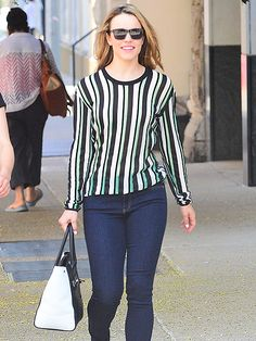 Rachel McAdams was seeing stripes in a linear-printed blouse, paired with chic angular rectangular sunnies!