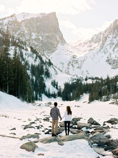 This duo's snowy location was so breathtaking, they had to stop and take it all in before continuing their session.
