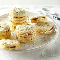 """Raspberry Almonettes Recipe -Sometimes that """"missing ingredient"""" idea comes to me in my sleep, and I have to jot it down. The surprising filling in these cookies make them fun to bake and even more fun to eat! —Angela Sheridan, Opdyke, Illinois"""