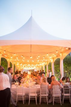 If you are planning an outdoor wedding yet afraid of bad weather, go for a cool wedding tent! Tents provide you with countless decorating opportunities and styles, and allow you to create any atmosphere you want. Wedding Tent Lighting, Outdoor Wedding Decorations, Marquee Wedding, Party Tent Decorations, Outdoor Tent Wedding, Outdoor Lighting, Event Lighting, Backyard Wedding Receptions, White Tent Wedding