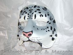 snow leopard makeup | Slush Cast Latex Cat Face painted as a snow leopard with whiskers.