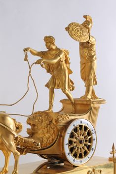 An attractive French Empire ormolu sculptural chariot mantel clock, by Le Roy, circa 1800 Wall Clock Brands, Wall Clock Online, Antique Wall Clocks, Vintage Clocks, Wall Clock Luxury, Lion Mask, Classic Clocks, Mantel Clocks, Wall Clock Design