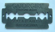 Metal label for Gatorgirl couture jeans.