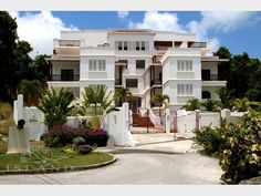 Island Villas - Barbados - Ashanti No. 8  Sale Price: USD $350,000.00     Bedrooms: 3  Bathrooms: 3 (1 Half)  Pool: YES  Ashanti No. 8 is one of nine unfurnished luxury condominiums in a small gated development, with private car parking spaces and a large communal pool located in St. Peter, Barbados.