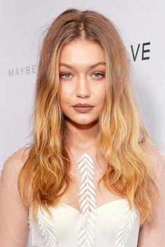 Are you in need of a wintry hair hue that isn't deep brown or snowy platinum? The solution is dark blond. The easy color has a wide spectrum of shades, so it works for all complexions. Gigi Hadid is a known natural ash, but earlier this year she played with lighter ends to contrast her dark blond roots.