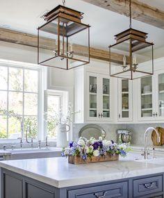 White Kitchen + marble Counters + Lantern Pendants + farmhouse sink
