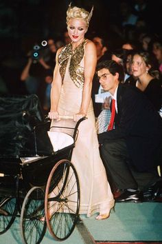 October 18 1994 Madonna walked in his spring/summer 1995 show, pushing a pram and wearing a headpiece with pointed ears.  Photo By Rex Features