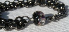 lovely bracelet by CloverBlue Jewelry designs featuring one of our Black Tie Grape organic lampwork beads :)