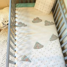 Girl mountain blanket or woodland crib quilt for woodland, boho chic nursery. From sleepinglakedesigns on Etsy.
