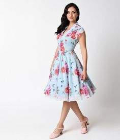 Bloomsbury beckons! Brand new from Hell Bunny in soft summery floral hues set against light blue, the Bloomsbury 1950s swing is a divertingly divine dress! This elegant frock features a gauzy vintage silhouette with a gathered and faux buttoned bodice and
