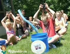 Water Bucket Relay Game for Kids.  carry water from full bucket over head and fill empty bucket at the end of the line