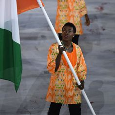 Ivory Coast's flagbearer Murielle Ahoure leads her delegation during the opening ceremony of the Rio 2016 Olympic Games at the…