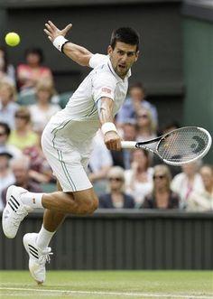 Novak Djokovic of Serbia plays a return to Radek Stepanek of the Czech Republic during a third round men's singles match at the All England Lawn Tennis Championships at Wimbledon, England, Friday, June 29, 2012. (AP Photo/Alastair Grant)