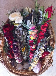 Handmade smudge sticks... beautiful white sage bundles wrapped with rosemary, rose buds and petals, lavender and blue or black sage and tied with embroidery floss. Elders have burned these sacred herbs for centuries in order to clear and consecrate their space. The smoke of white sage is said to draw positive spirits and discourage the presence of any unwanted energy, rosemary and lavender are burned for health, and roses for love.