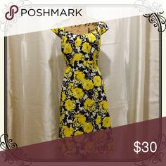 Gorgeous retro-style yellow and black floral dress Gorgeous! Fitted to skim the body and flatter your curves. Abstract yellow, black, gray and white floral. Fits true to size. London Times Dresses Midi