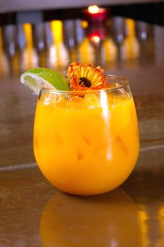 """Soul of a Nation"" (peach schnapps, mango puree and Champagne)"