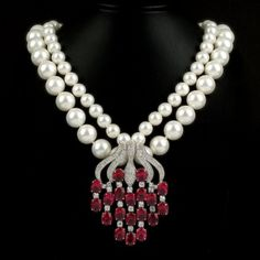 #Shell #pearl necklace with ruby red pendant. Also Available in emerald green, white and sapphire blue. 45cm lenght.