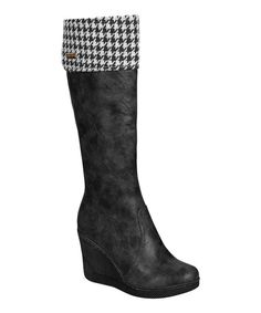 Be fashionably ready for cooler temps in this stylish boot, which features a fabric lining in a chic houndstooth print.3.75'' heel13.5'' shaft15'' circumferenceSide zipper closureCushioned footbed