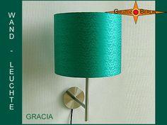 Wandleuchte GRACIA Ø 20 cm Seide Smaragdgrün. Edel und wie ein Juwel im Raum: Die Wandleuchte GRACIA besticht durch Farbe und den matten Glanz des Seidensatin mit Jacquardmuster.
